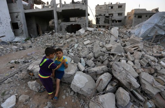 Two boys play amid the rubble left by Israel's attacks on Gaza; the European Union is eager to increase trade with the pepertrator of those attacks.  (Mohammed Asad / APA images)